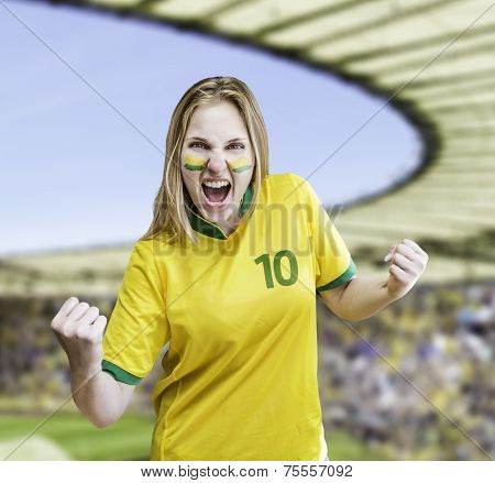 Brazilian woman celebrates on the stadium with her face painted