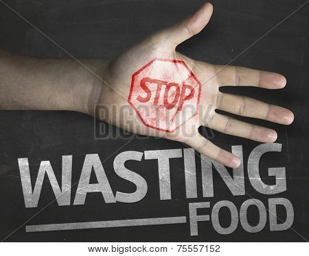 Educational and Creative composition with the message Stop Wasting Food on the blackboard