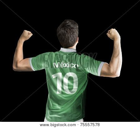 Mexican soccer player celebrates on black background