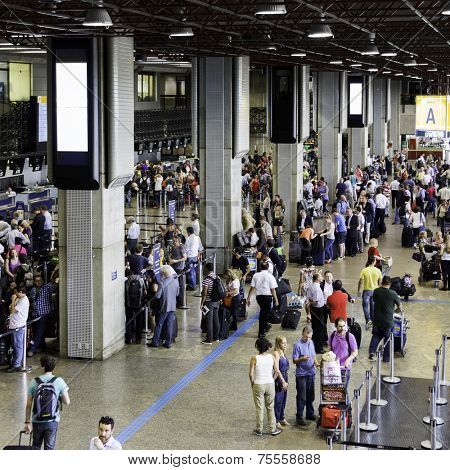 SAO PAULO, BRAZIL - CIRCA JANUARY 2014: Passengers walk through Guarulhos Airport in Sao Paulo, Brazil. Guarulhos is the main airport serving Sao Paulo, Brazil.