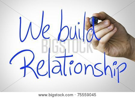 We build relationship hand writing on blue marker on transparent wipe board