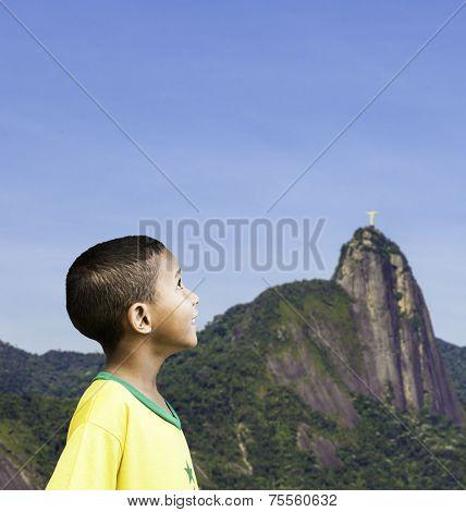 Brazilian little boy looks to the sky in Rio de Janeiro, Brazil