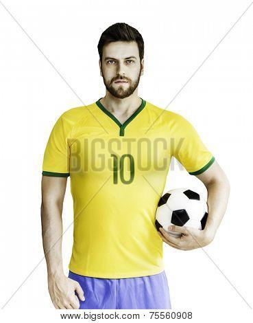 Brazilian soccer player holds a soccer ball on white background