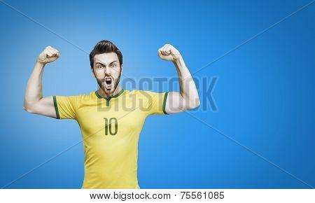 Brazilian soccer player celebrates on blue background