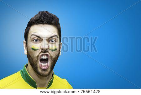 Brazilian fan celebrates on blue background