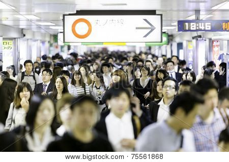 TOKYO, JAPAN - CIRCA MAY 2014: Passengers hurry at Ikebukuro station in Tokyo, Japan. Ikebukuru is the second-busiest railway station in the world