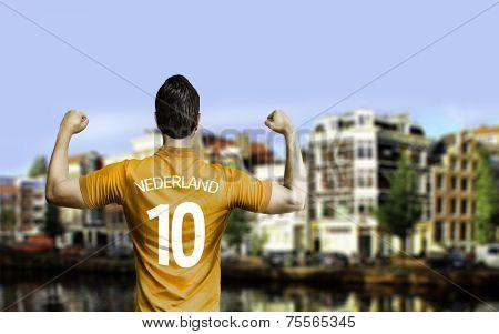 Dutchman soccer player celebrates in Amsterdam, Netherlands