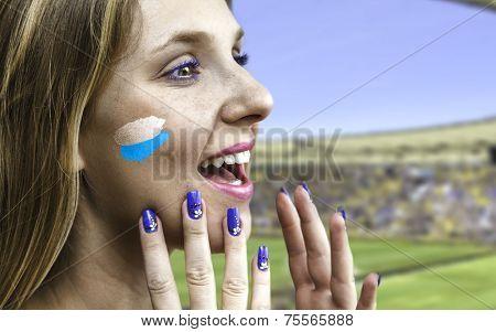Blonde Argentinian fan celebrates in the stadium