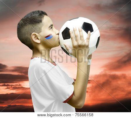 American little boy kissing a soccer ball