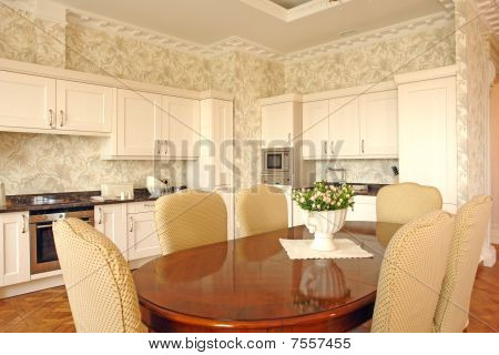 interior of a dinning room and a kitchen