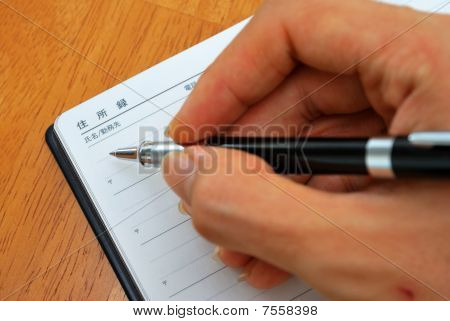 Hand Writing With Pen On Japanese Address Book