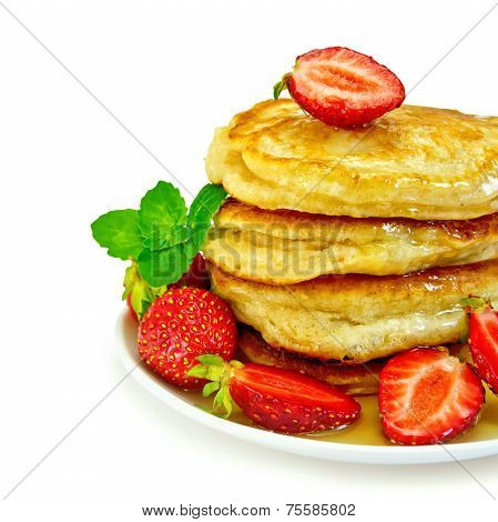 Flapjacks with strawberries and mint