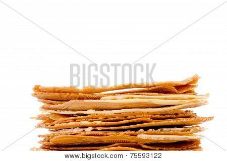 Fresh baked krumkakes on white background brightened poster