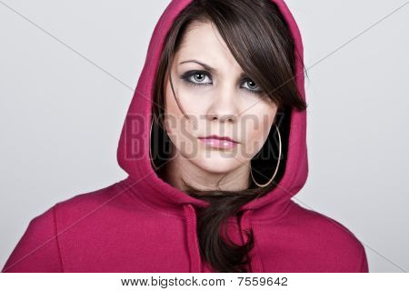 Female Hoodie Against Grey Background