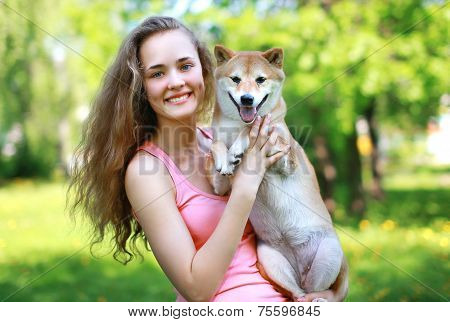 Happy charming girl owner holding loving dog poster