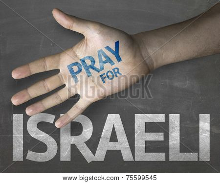 Educational and Creative composition with the message Pray for Israeli on the blackboard