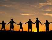 Many people join hands to represent a family unity. poster