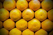 Closeup of whole ripe oranges for background poster
