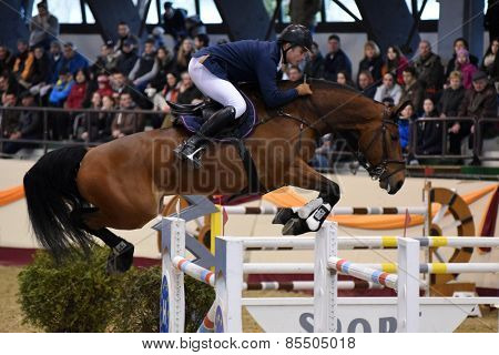 KAPOSVAR, HUNGARY - MARCH 15: Marton Reischl jumps with his horse (Latino) on the Masters Tournament International Jumping Competition, March 15, 2015 in Kaposvar, Hungary