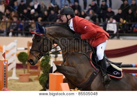 KAPOSVAR, HUNGARY - MARCH 15: Laszlo Kiss jumps with his horse (Salute) on the Masters Tournament International Jumping Competition, March 15, 2015 in Kaposvar, Hungary