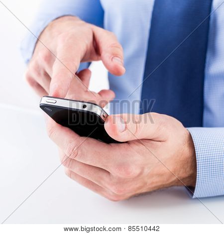 Businessman using a smart phone.