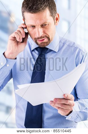 Young businessman making a phone call.