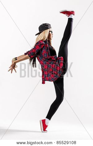 young hip-hop dancer posing in studio