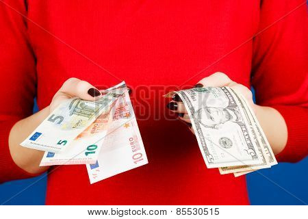 Euro And Dolar In The Hands Of A Girl