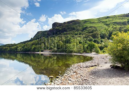 Barrow Bay Derwent Water on calm still summer morning in the English lake District