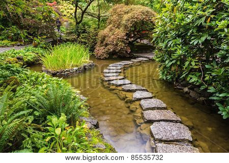 Amazingly beautiful decorative private garden in western Canada Butchart Gardens. The track of the stones in the Japanese part of the garden