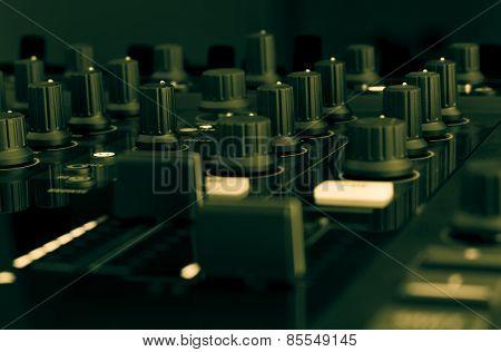 DJ mixer in a music studio, close up.