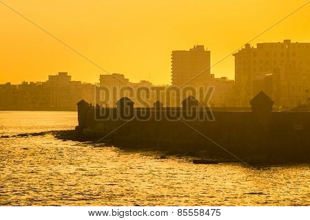 Colorful surise in Havana with a view of the malecon seawall and the city skyline