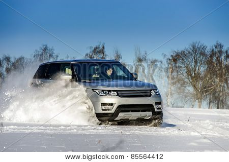 Powerful 4X4 Offroader Car Running On Snow Field