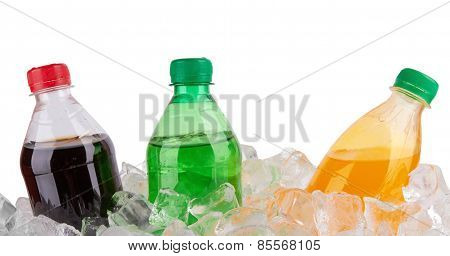 cold beverages in plastic bottles on heap of ice cubes poster