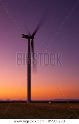Windfarm at sunset and sky with dust from Kasatochi volcano poster