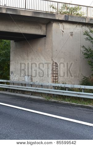 damaged concrete highway bridge