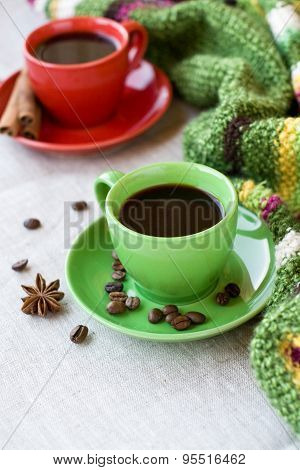 Green And Red Cups Of Coffee With Coffee Bence, Anise Star And Cinnamon Chopsticks