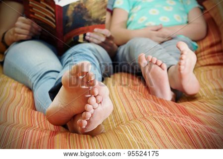 Feet Of Reading Mom And Daughter