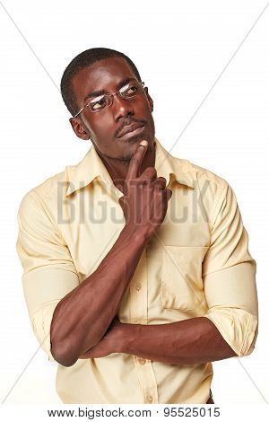 Young  black african man thinking and reminiscing about something