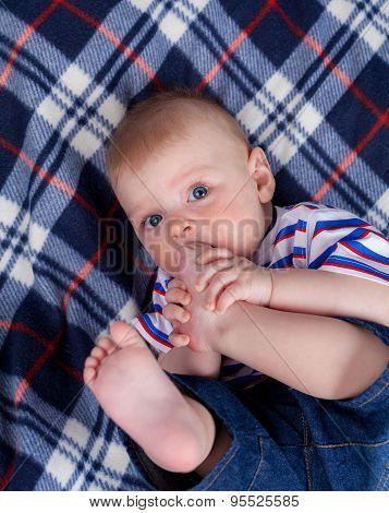 Cute baby nipping his feet