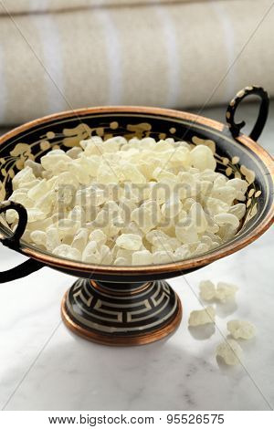 Mastic tears of Chios in a Greek bowl for cosmetic use