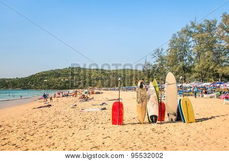Surfboards At A Tropical Beach - Extreme Sport Body Boards In A Sunny Day With Tourists