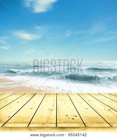 Yellow sand beach and blue sky and sea with wooden floor