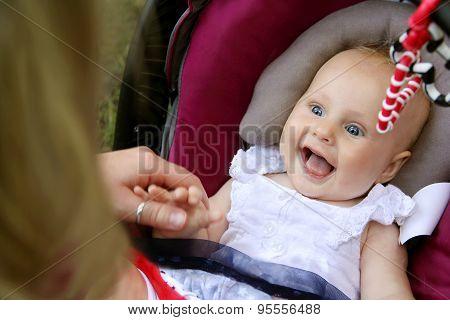 Laughing Newborn Baby Girl In Car Seat