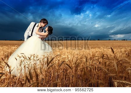 Young Couple Getting Married In Wheat Field