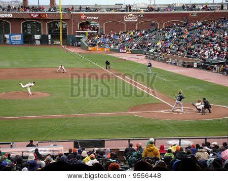 Giants Pitcher Tim Lincecum Throws A Pitch To Braves Matt Diaz, Ball Visible In Air