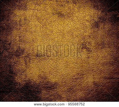 Grunge background of dark goldenrod leather texture