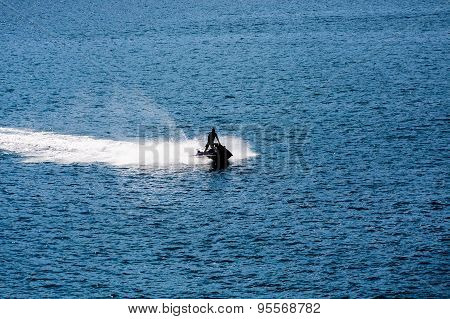 Jet Ski Sillouette On Blue