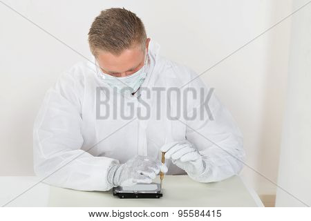 Man Wearing Mask And Glove Repairing Harddisk