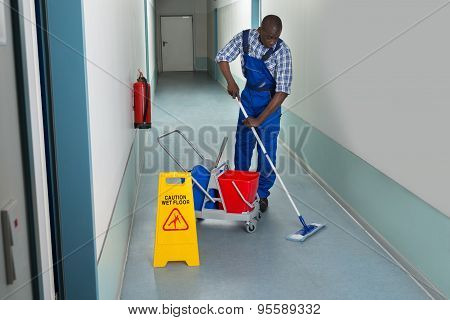 Male Janitor Cleaning Floor